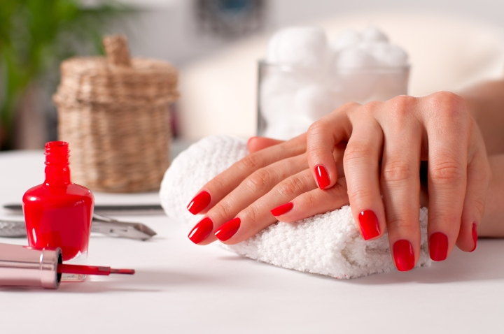 Hand Care. Beautiful Manicure, Woman's Hands With Red Nails